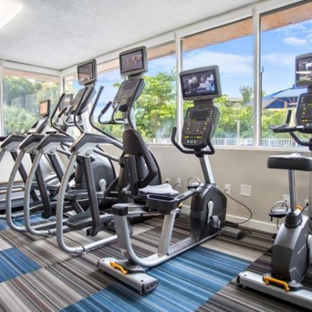 Fitness center with cardio machines.