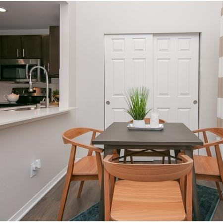 Separate dining area with peek-through kitchen.