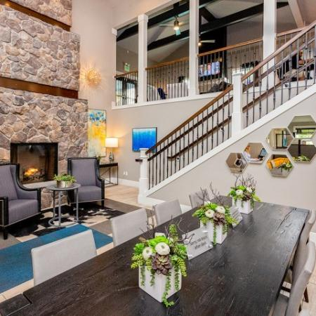Clubhouse lobby with stair railing and fireplace.