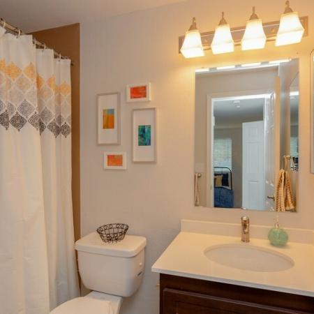 Bathroom with white and espresso vanity.