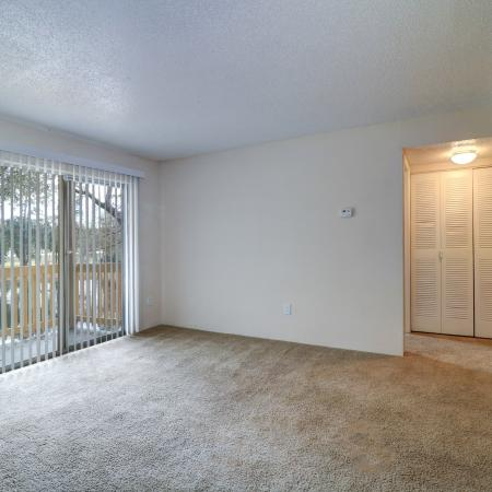 Oak Grove Apartments LLC, interior, living room, carpet, wood floor, sliding glass doors with blinds, hallway closet