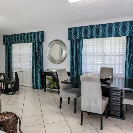 The Avenue Apartments, interior, green drapes, table and chairs for four, tile floor, large windows