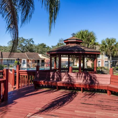 The Avenue Apartments, exterior, gazebo, red wood bench seating, palm trees