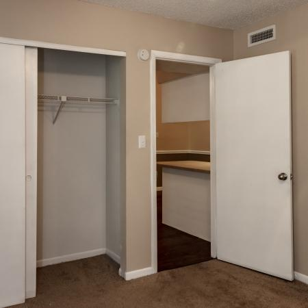 The Avenue Apartments, interior, bedroom off the kitchen, ceiling fan, closet, carpet