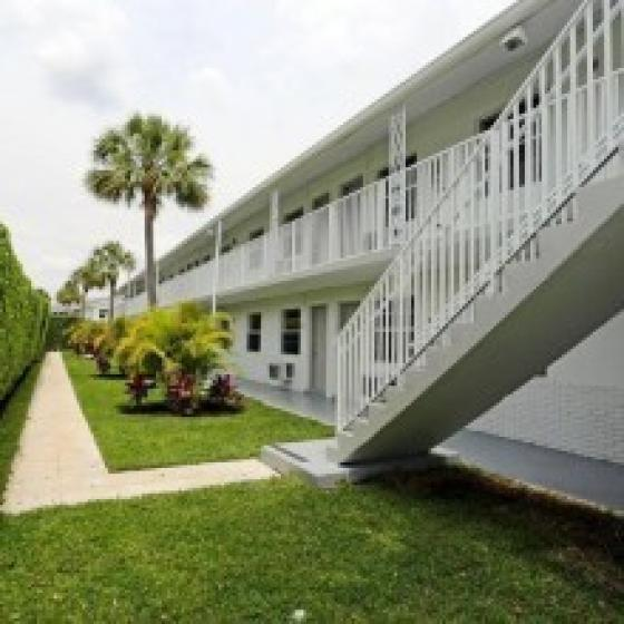 Jade at Olde Naples, exterior, grass, trees, walk ways, stairs, two level white building