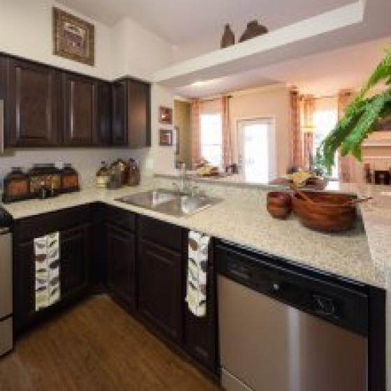 Kitchen with white countertops and dark cabinets