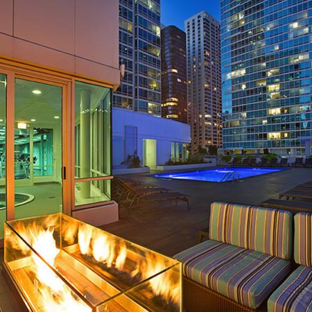 Lounging by the Pool | The Streeter Luxury Apartments