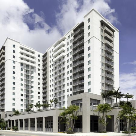 109 Tower, exterior, white high rise building, balconies, main entrance, palm trees