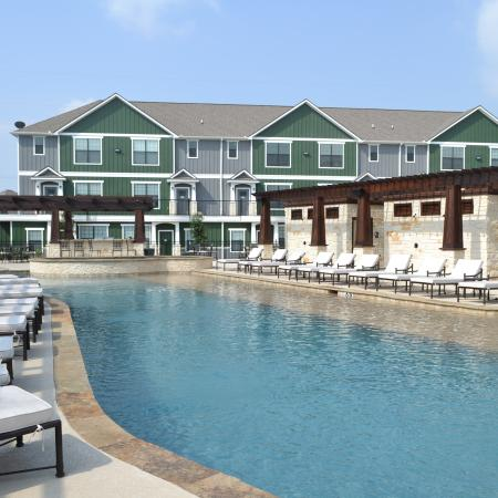 Sundeck by resident swimming pool