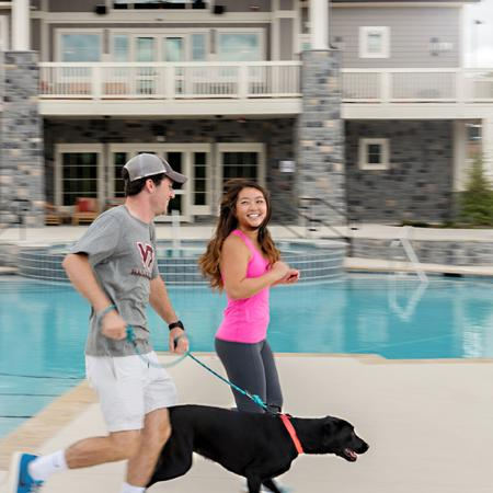 Residents Running with Dog by Pool