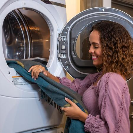 Residents Doing Laundry in Laundry Room