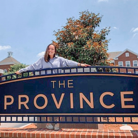 Girl standing with Province Sign