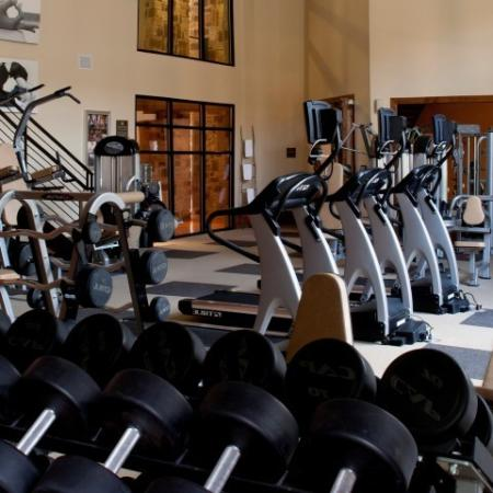 Residents Working Out at Fitness Center | Apartments In Knox Henderson | Fitzhugh Urban Flats
