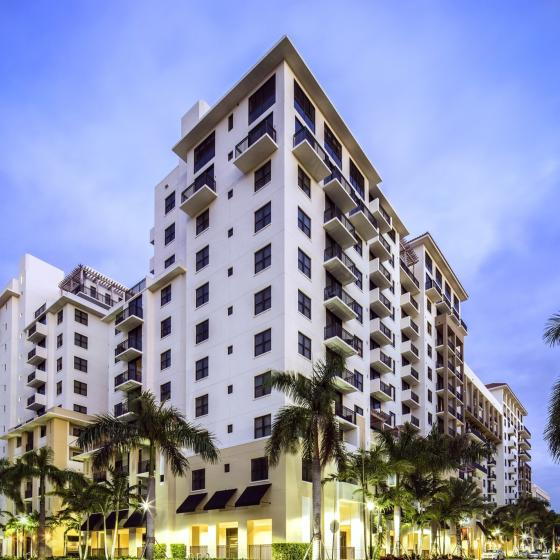 The Mark at Cityscape, exterior, tall white building, balconies, palm trees