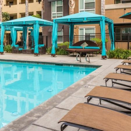 Outdoor Pool + Lounge Chairs + Cabanas
