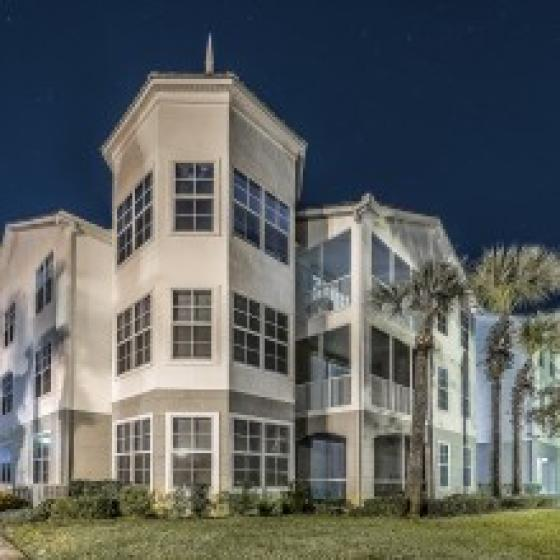 Avana Westchase, exterior, three story tan building, palm trees
