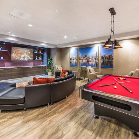 Rec room with billiards, ping-pong table, lounge, and massive flat-screen TV