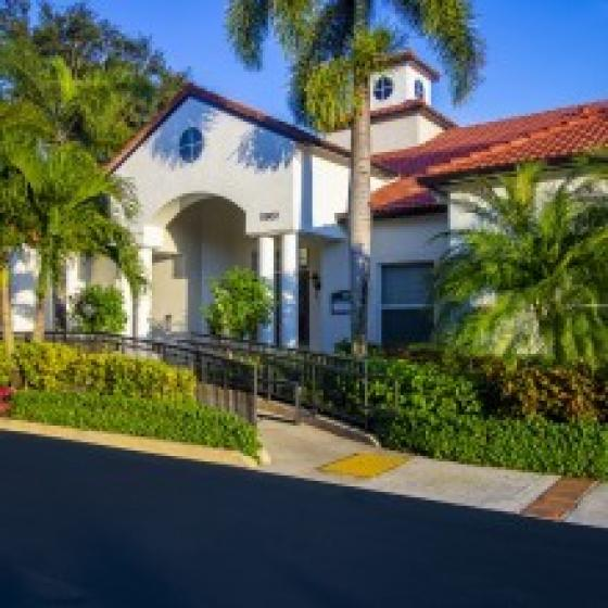 Mira Flores, exterior, white building, red roof, street, greens, palm trees