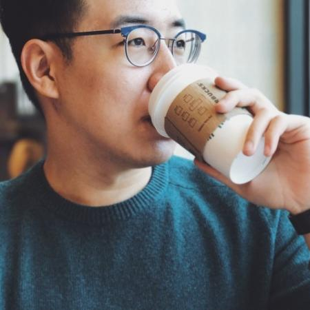 man drinking starbucks coffee
