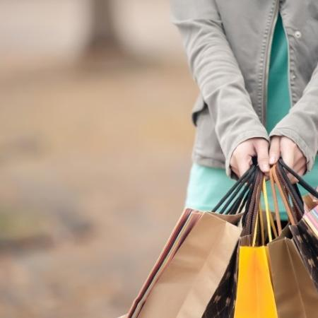 Girl Holding Shopping Bags Outdoors