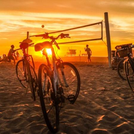 Beach Sunset with Bikes and Volleyball Net