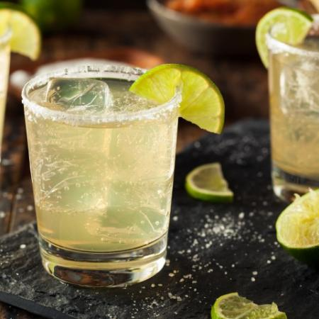 Margaritas with Lime on Black Table