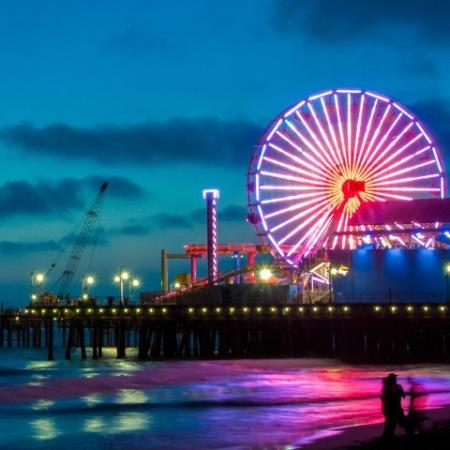 Santa Monica Pier at Night with Lit Up Pink Colored Carousel