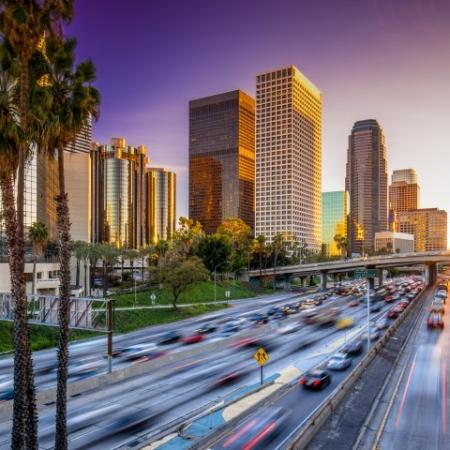 Los Angeles Freeway with Sunset and High Rise Buildings