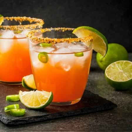Red Colored Cocktails with Lime and Jalapenos