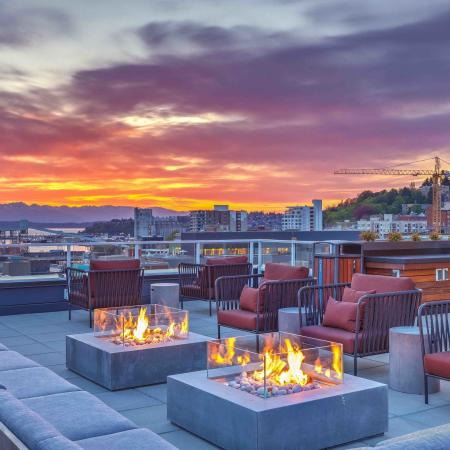 Rooftop view at night with Fire pits