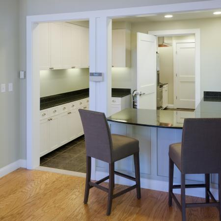 Clubhouse kitchen with bar and seating