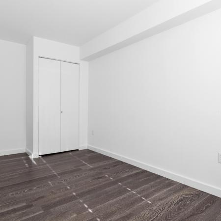 Large bedrooms with wood like floors and dual door closet