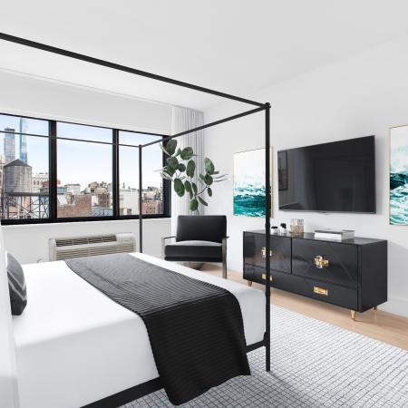 Bed room with large canopy bed, beautiful window views of the city and tv