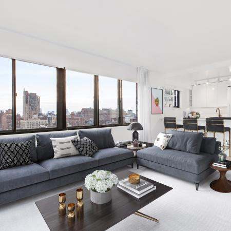 Living room with couch, loveseat,coffee table overlooking city view