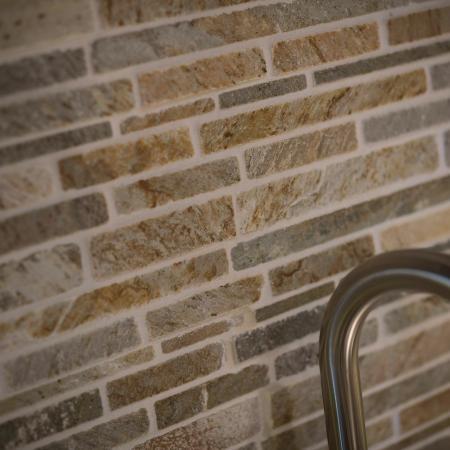 Kitchen sink with brick backsplash
