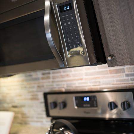 Kitchen stainless steel stove and microwave