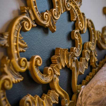 Bed head board made of gold and blue