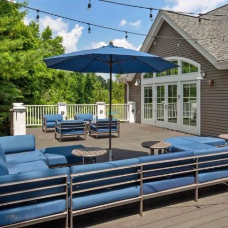 Deck around pool with comfortable cushioned seating