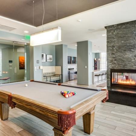 Billiards by Fireplace in Clubhouse