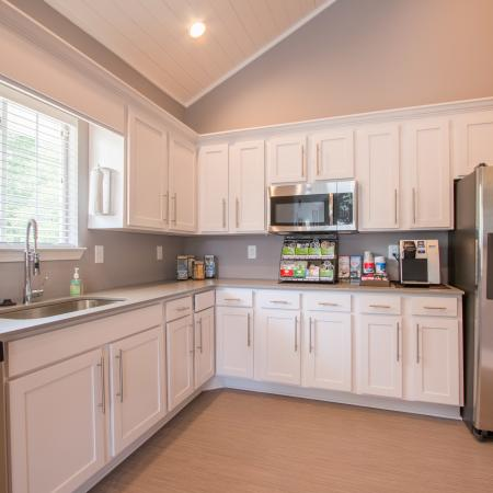 Kitchen with white cabinets and stainless appliances