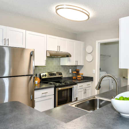 Kitchen, stainless steel range, white cabinets and pantry
