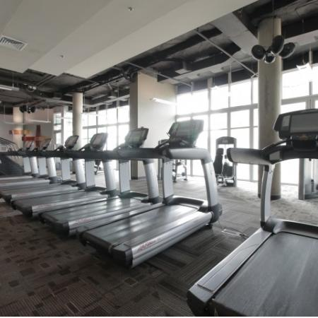 West Sixth Apartments Lifestyle - 24 Hour Fitness Gym Cardio Equipment
