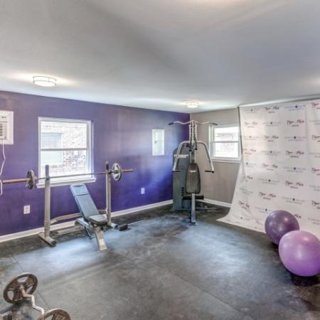 Tiger Plaza Apartments Lifestyle - 24 Hour Fitness Gym Weights Equipment