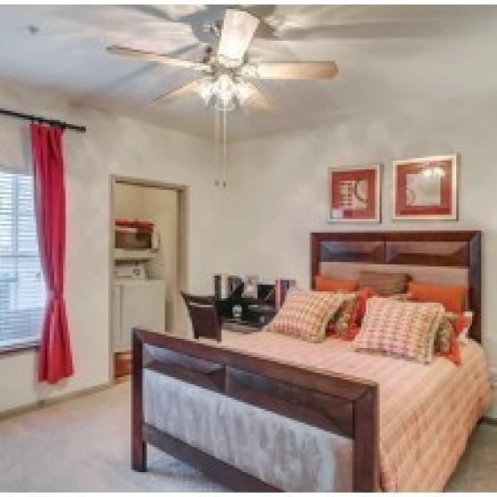 Advenir at The Preserve, interior, bedroom, creame and peach colors, large bed, ceiling fan