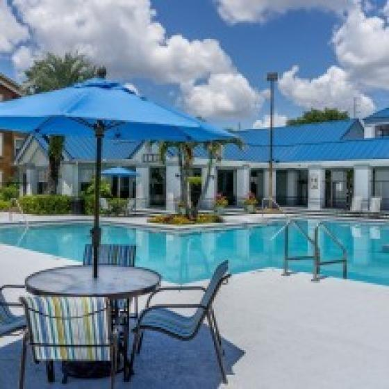 Advenir at Polos East, exterior, Resort Inspired Swimming pool, umbrella shaded tables and chairs