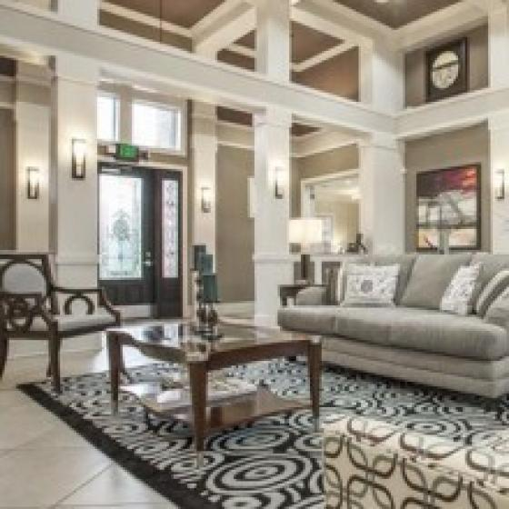 Advenir at Eagle Creek, interior, clubhouse seating area, light colors, creams and grays