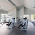 Fitness center with treadmills, free-weights, benches and cardio-equipment.