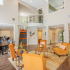 Community Center with high ceilings, coffee bar for residents to enjoy two large sofas as sitting options.