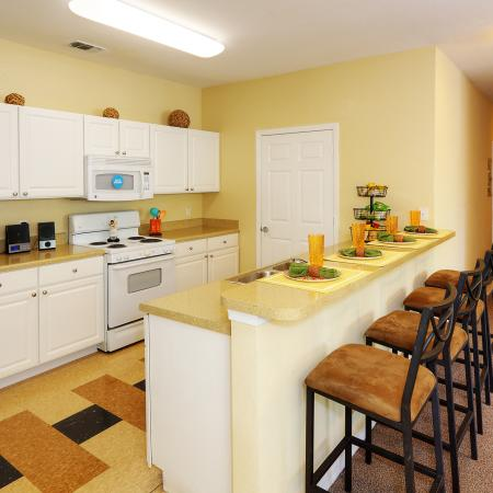 Well light kitchen complete with island and serving bar | refrigerator, oven, and microwave are included | Ample cabinet and counter top space | Hawks Landing