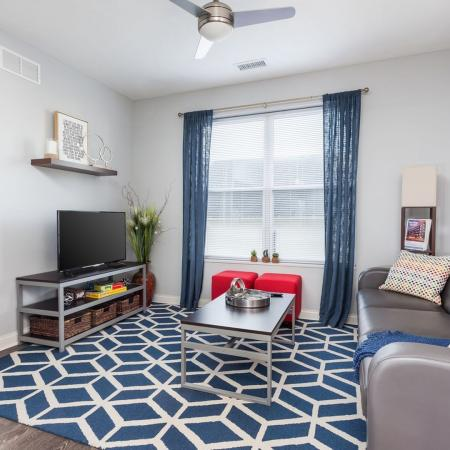 Residents Lounging in the Living Room | Kent OH Apartments For Rent | 345 Flats